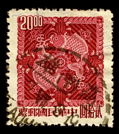China-Taiwan CIRCA 1965:A stamp printed in China-Taiwan shows image of double carp, circa 1965. Stock Photo - 11302622