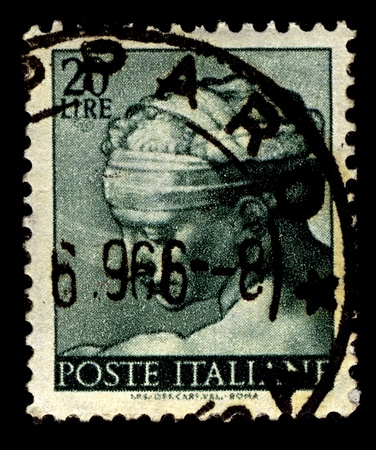 Italy-CIRCA 1961:A stamp printed in Italy shows image of The Libyan Sibyl, named Phemonoe, was the prophetic priestess presiding over the Zeus Ammon Oracle at Siwa Oasis in the Libyan Desert, circa 1961. Stock Photo - 11306187