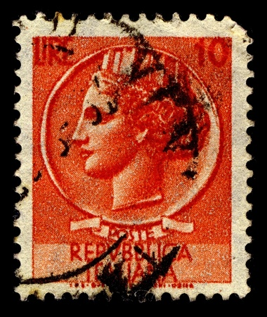 Italy-CIRCA 1968:A stamp printed in Italy shows image of Italia with mural crown after Medallion from Syracuse, circa 1968. Stock Photo - 11306207