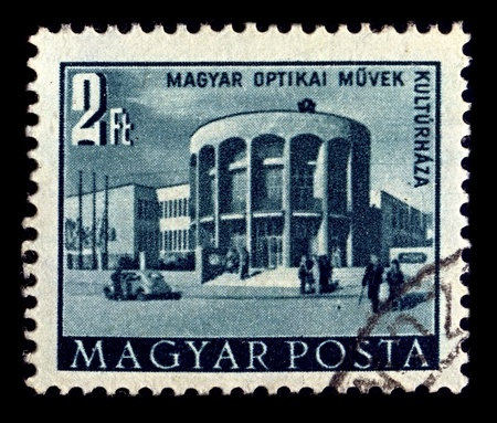 Hungary-CIRCA 1953:A stamp printed in Hungary shows image of cultural house of the Hungarian Optical Works, circa 1953.