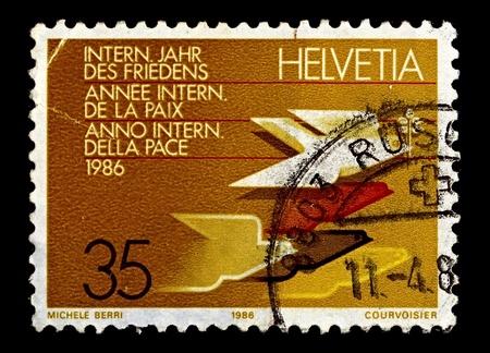 Switzerland-CIRCA 1986:A stamp printed in Switzerland shows image of International Year of Peace, circa 1986.