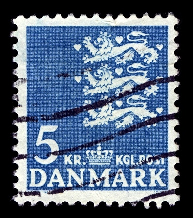 Denmark-CIRCA 1946:A stamp printed in Denmark shows image of The national coat of arms of Denmark consists of three crowned blue lions accompanied by nine red hearts, all in a golden shield, circa 1946.