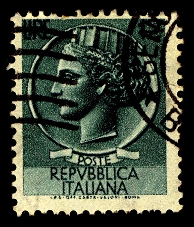 characterised: Italy-CIRCA 1955:A stamp printed in Italy shows image of Italia Turrita is the national personification or allegory of Italy, characterised by a mural crown typical of Italian civic heraldry of communal origin, circa 1955.