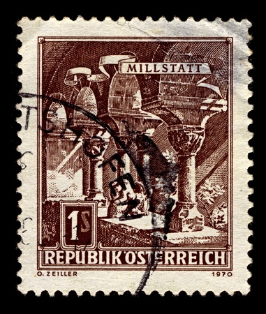 finally: AUSTRIA-CIRCA 1970:A stamp printed in AUSTRIA shows image of Millstatt Abbey is a former monastery at Millstatt in the Austrian state of Carinthia, which was established about 1070 and finally abolished in 1773, circa 1970.