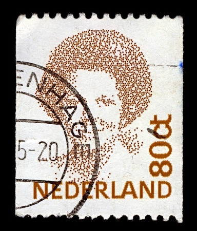 regnant: NETHERLANDS-CIRCA 1991:A stamp printed in NETHERLANDS shows image of Beatrix (Beatrix Wilhelmina Armgard) is the Queen regnant of the Kingdom of the Netherlands comprising the Netherlands, Curacao, Sint Maarten, and Aruba, circa 1991.