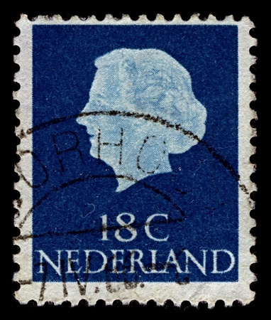 regnant: NETHERLANDS-CIRCA 1965:A stamp printed in NETHERLANDS shows image of Juliana (Juliana Louise Emma Marie Wilhelmina) was the Queen regnant of the Kingdom of the Netherlands between 1948 and 1980, circa 1965.