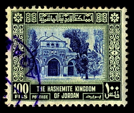 sunni: JORDAN-CIRCA 1954:A stamp printed in Jordan shows image of Al-Aqsa Mosque  also known as al-Aqsa, is the third holiest site in Sunni Islam and is located in the Old City of Jerusalem, circa 1954.