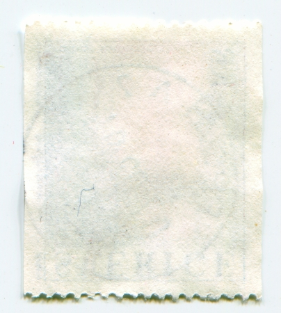 The reverse side of a postage stamp  photo