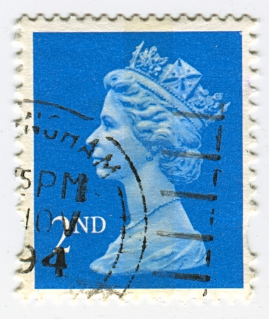 constitutional: UK-CIRCA 1960:A stamp printed in UK shows image of Elizabeth II is the constitutional monarch of 16 sovereign states known as the Commonwealth realms, head of the 54-member Commonwealth of Nations, in blue, circa 1960.