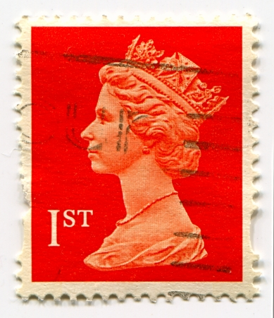 alexandra: UK-CIRCA 1960:A stamp printed in UK shows image of Elizabeth II is the constitutional monarch of 16 sovereign states known as the Commonwealth realms, head of the 54-member Commonwealth of Nations, in red, circa 1960.