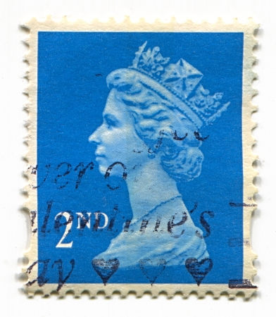 known: UK-CIRCA 1960:A stamp printed in UK shows image of Elizabeth II is the constitutional monarch of 16 sovereign states known as the Commonwealth realms, head of the 54-member Commonwealth of Nations, in blue, circa 1960.
