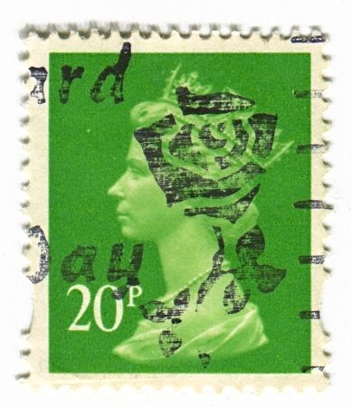 constitutional: UK-CIRCA 1960:A stamp printed in UK shows image of Elizabeth II is the constitutional monarch of 16 sovereign states known as the Commonwealth realms, head of the 54-member Commonwealth of Nations, in green, circa 1960.