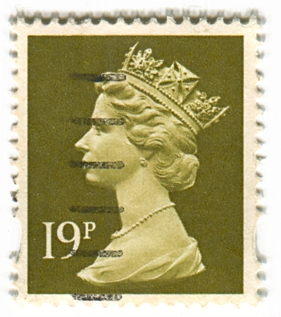 realms: UK-CIRCA 1960:A stamp printed in UK shows image of Elizabeth II is the constitutional monarch of 16 sovereign states known as the Commonwealth realms, head of the 54-member Commonwealth of Nations, in green, circa 1960.