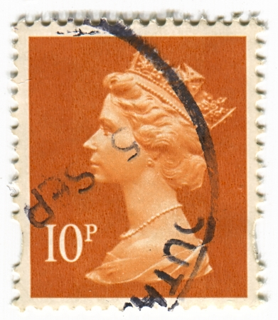 realms: UK-CIRCA 1960:A stamp printed in UK shows image of Elizabeth II is the constitutional monarch of 16 sovereign states known as the Commonwealth realms, head of the 54-member Commonwealth of Nations, in orange, circa 1960.