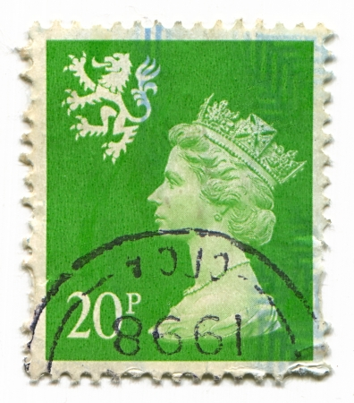 realms: UK-CIRCA 1998:A stamp printed in UK shows image of Elizabeth II is the constitutional monarch of 16 sovereign states known as the Commonwealth realms, head of the 54-member Commonwealth of Nations, in green, circa 1998. Editorial