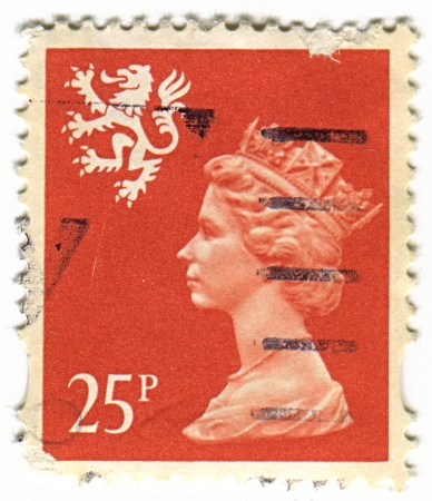 realms: UK-CIRCA 1960:A stamp printed in UK shows image of Elizabeth II is the constitutional monarch of 16 sovereign states known as the Commonwealth realms, head of the 54-member Commonwealth of Nations, in pink, circa 1960.