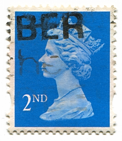 UK-CIRCA 1960:A stamp printed in UK shows image of Elizabeth II is the constitutional monarch of 16 sovereign states known as the Commonwealth realms, head of the 54-member Commonwealth of Nations, in blue, circa 1960.