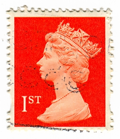 realms: UK-CIRCA 1960:A stamp printed in UK shows image of Elizabeth II is the constitutional monarch of 16 sovereign states known as the Commonwealth realms, head of the 54-member Commonwealth of Nations, in red, circa 1960.
