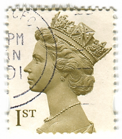 realms: UK-CIRCA 1960:A stamp printed in UK shows image of Elizabeth II is the constitutional monarch of 16 sovereign states known as the Commonwealth realms, head of the 54-member Commonwealth of Nations, in white, circa 1960. Editorial