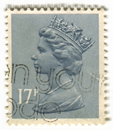 commonwealth: UK-CIRCA 1960:A stamp printed in UK shows image of Elizabeth II is the constitutional monarch of 16 sovereign states known as the Commonwealth realms, head of the 54-member Commonwealth of Nations, in grey, circa 1960.