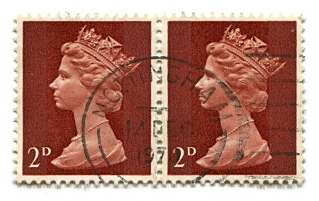 UK-CIRCA 1970:A stamp printed in UK shows image of Elizabeth II is the constitutional monarch of 16 sovereign states known as the Commonwealth realms, head of the 54-member Commonwealth of Nations, in brown, circa 1970.