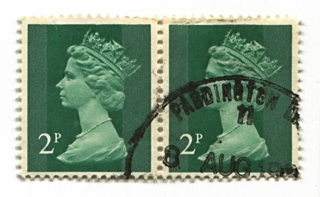 alexandra: UK-CIRCA 1990:A stamp printed in UK shows image of Elizabeth II is the constitutional monarch of 16 sovereign states known as the Commonwealth realms, head of the 54-member Commonwealth of Nations, in green, circa 1990.
