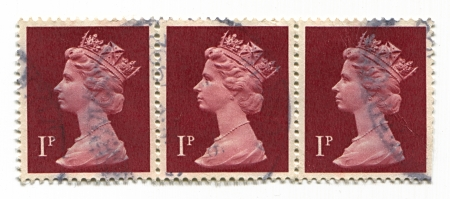 realms: UK-CIRCA 1960:A stamp printed in UK shows image of Elizabeth II is the constitutional monarch of 16 sovereign states known as the Commonwealth realms, head of the 54-member Commonwealth of Nations, in purple, circa 1960.