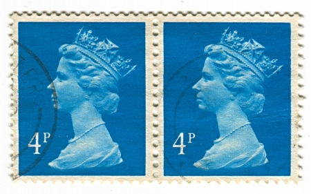 realms: UK-CIRCA 1960:A stamp printed in UK shows image of Elizabeth II is the constitutional monarch of 16 sovereign states known as the Commonwealth realms, head of the 54-member Commonwealth of Nations, in blue, circa 1960.
