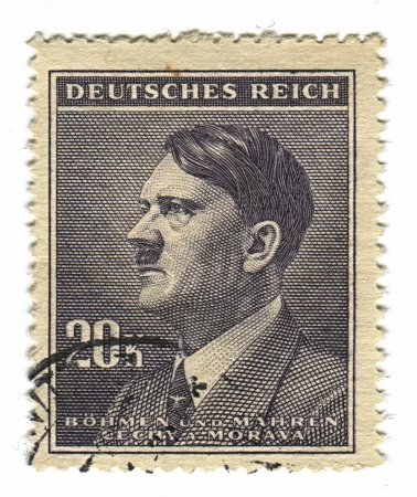 adolf: GERMANY - CIRCA 1937: A stamp printed in Germany shows image of Adolf Hitler was an Austrian-born German politician and the leader of the Nazi Party, in black, circa 1937.  Editorial