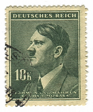 adolf: GERMANY - CIRCA 1937: A stamp printed in Germany shows image of Adolf Hitler was an Austrian-born German politician and the leader of the Nazi Party, in green, circa 1937.  Editorial