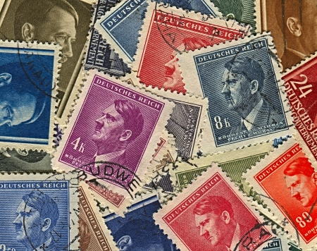 adolf: GERMANY - CIRCA 1937: A stamps printed in Germany shows image of Adolf Hitler was an Austrian-born German politician and the leader of the Nazi Party, circa 1937.