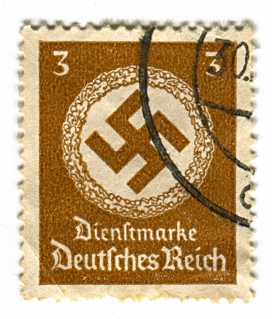 GERMANY - CIRCA 1937: A stamp printed in Germany shows image of the swastika  is an equilateral cross with four arms bent at right angles, in blue, brown 1937.