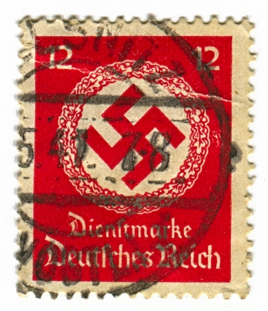 swastika: GERMANY - CIRCA 1941: A stamp printed in Germany shows image of the swastika  is an equilateral cross with four arms bent at right angles, in red, circa 1941.