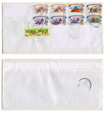 kreml: RUSSIA - CIRCA 2012: Mailing envelope with postage stamps dedicated to Russian kremlins and animals, and the reverse side, circa 2012.