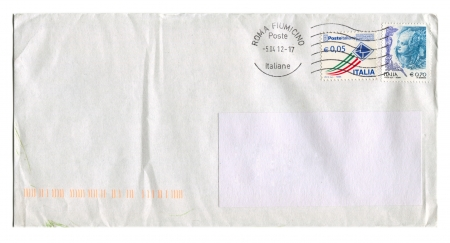 ITALIA - CIRCA 2012: Mailing envelope with postage stamps dedicated to Italian Poste and Woman, circa 2012.