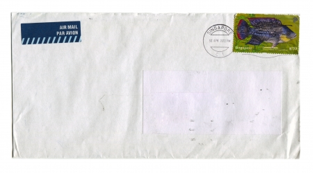 SINGAPORE - CIRCA 2012: Mailing envelope with postage stamps dedicated to Common Tllapia Fish, circa 2012. Stock Photo - 15838910
