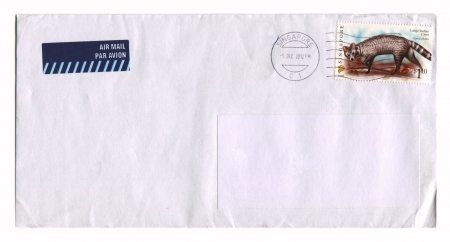 SINGAPORE - CIRCA 2012: Mailing envelope with postage stamps dedicated to Large Indian Civet, circa 2012.