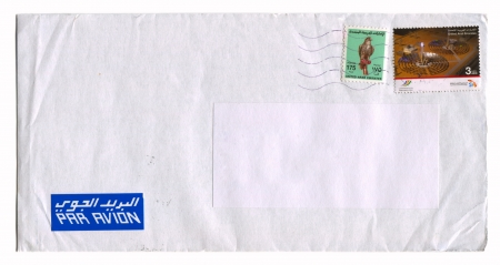 postmail: UNITED ARAB EMIRATES - CIRCA 2012: Mailing envelope with postage stamps dedicated to Bird and World Energy Forum, circa 2012.