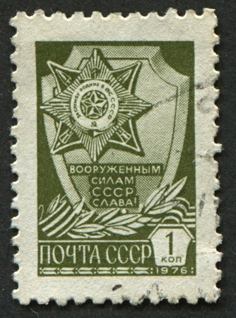 homeland: USSR - CIRCA 1976: A stamp printed in USSR shows image of The Order for Service to the Homeland, circa 1976.