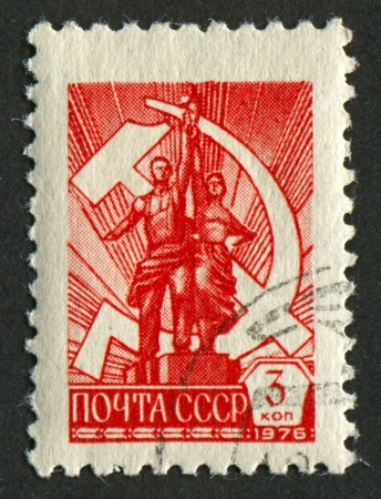 mediaval: USSR - CIRCA 1976: A stamp printed in USSR shows image of the Worker and Kolkhoz Woman sculpture, circa 1976.