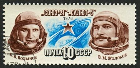 vitaly: USSR - CIRCA 1976: A stamp printed in USSR shows image of Vitaly Zholobov (1937) and Boris Volynov (1934) Russian cosmonauts, circa 1976.