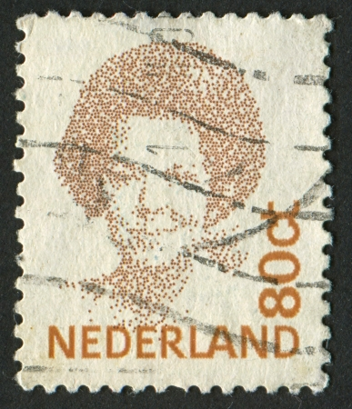regnant: NETHERLANDS - CIRCA 1991: A stamp printed in Netherlands shows image of Beatrix (1880), Queen regnant of Netherlands, circa 1991.