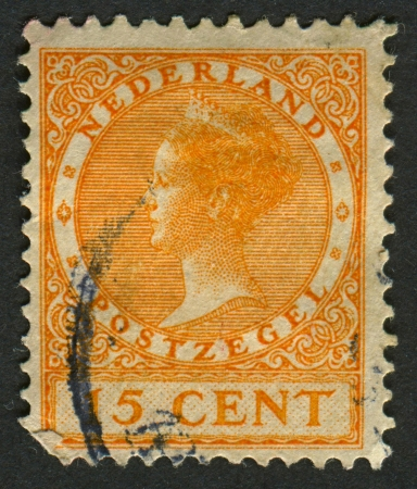 regnant: NETHERLANDS - CIRCA 1928: A stamp printed in Netherlands shows image of Wilhelmina (1880-1962), Queen regnant of Netherlands, circa 1928.