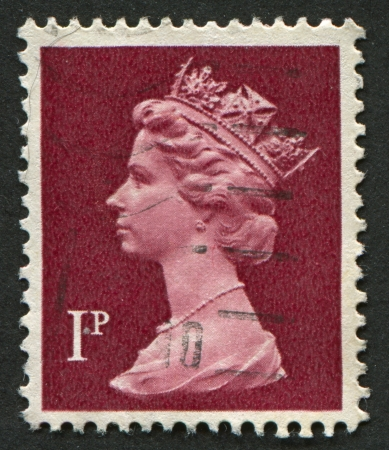 UK-CIRCA 1996:A stamp printed in UK shows image of Elizabeth II is the constitutional monarch of 16 sovereign states known as the Commonwealth realms, head of the 54-member Commonwealth of Nations, in brown, circa 1996.