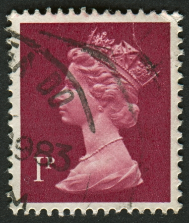 realms: UK-CIRCA 1983:A stamp printed in UK shows image of Elizabeth II is the constitutional monarch of 16 sovereign states known as the Commonwealth realms, head of the 54-member Commonwealth of Nations, in brown, circa 1983.