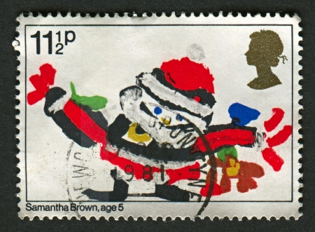 UK - CIRCA 1981: A stamp printed in UK shows image of the Santa Claus with gifts, circa 1981.