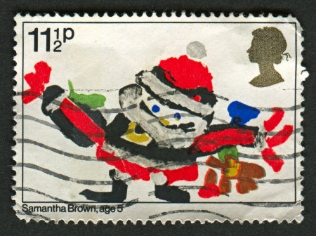 mediaval: UK - CIRCA 1981: A stamp printed in UK shows image of the Santa Claus with gifts, circa 1981.
