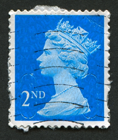 constitutional: UK-CIRCA 1989:A stamp printed in UK shows image of Elizabeth II is the constitutional monarch of 16 sovereign states known as the Commonwealth realms, in blue, circa 1989.