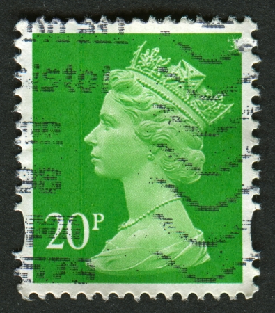 realms: UK-CIRCA 1988:A stamp printed in UK shows image of Elizabeth II is the constitutional monarch of 16 sovereign states known as the Commonwealth realms, in green, circa 1988.