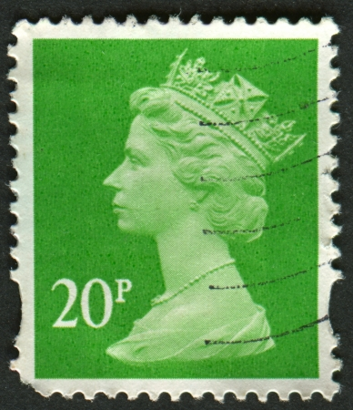 constitutional: UK-CIRCA 1988:A stamp printed in UK shows image of Elizabeth II is the constitutional monarch of 16 sovereign states known as the Commonwealth realms, in green, circa 1988.
